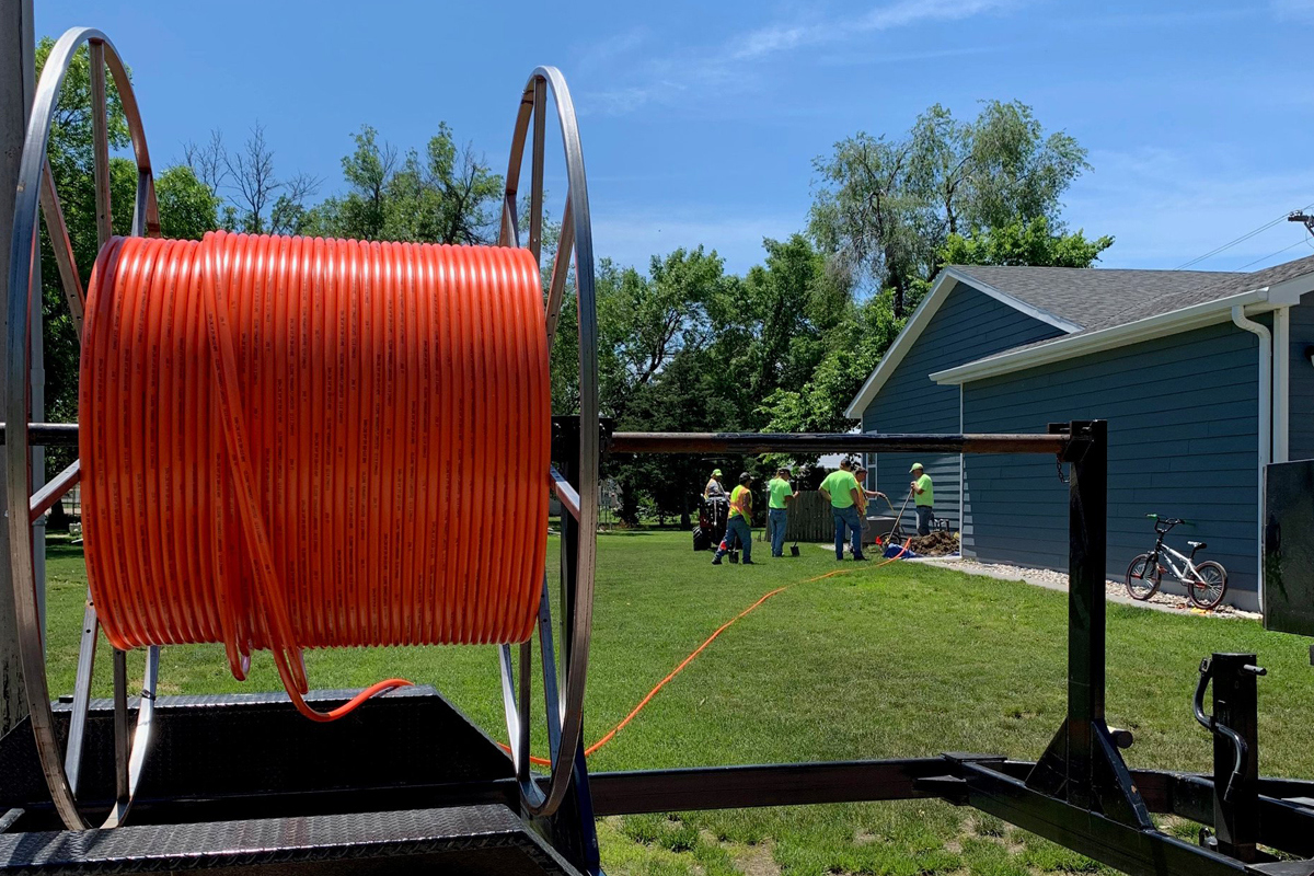 Large roll of fiber conduit at a home where fiber is being installed